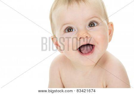Sweet little boy sitting on studio white background