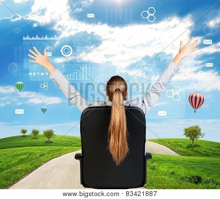 Businesswoman sitting on office chair. Green hills with sky and virtual elements