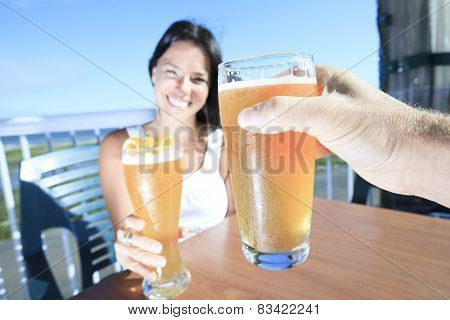A yoman drinking a beer with is friend