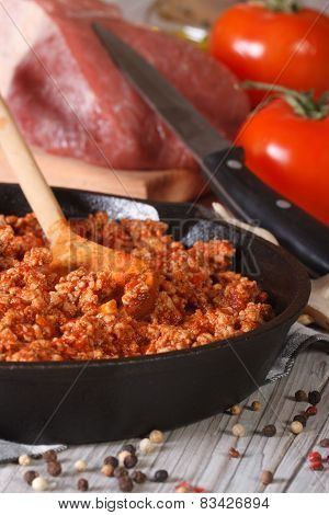 Bolognese Sauce In A Frying Pan Close-up Vertical