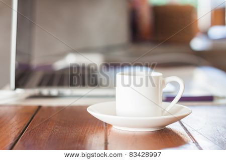 Mini White Coffee Cup On Work Station