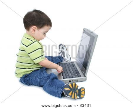 Adorable Boy With Working On Laptop Over White