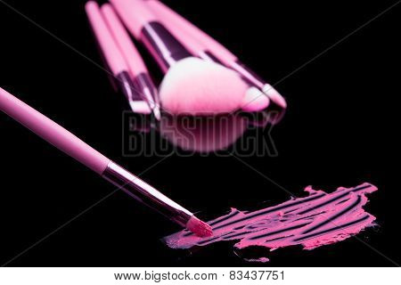 lipstick with a brush make-up on black