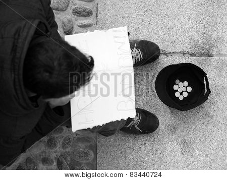 Homeless person with cardboard
