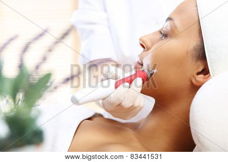 Microneedle mesotherapy treatment for neck the woman at the beautician
