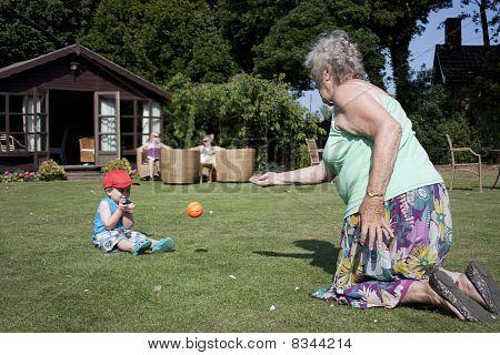Gran And Grandson Play Ball