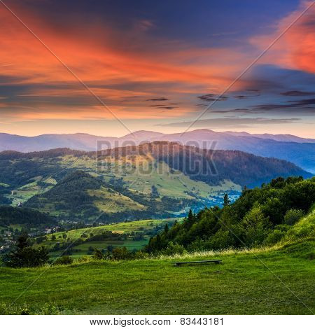 Village Near Forest In High Mountains At Sunrise