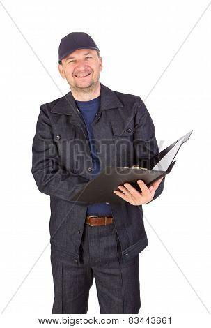 Man in hard hat holding folders.
