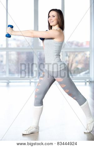 Beautiful Girl Doing Fitness Exercises With Dumbbells