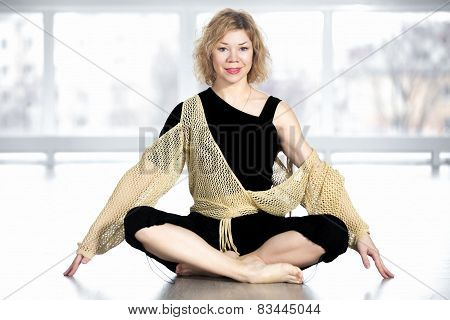 Happy Yogi Female Sitting Cross-legged In Yoga Pose