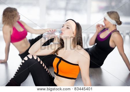 Sporty Girl Drinking Water In Fitness Class