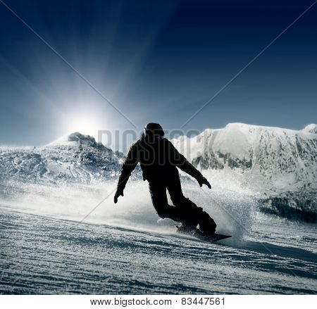 Snowboarder silhouette on the snow hills view