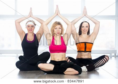Group Of Three Yogi Females Sitting In Easy Pose