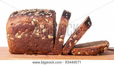 Unleavened Bread With Seeds Sliced On Cutting Board
