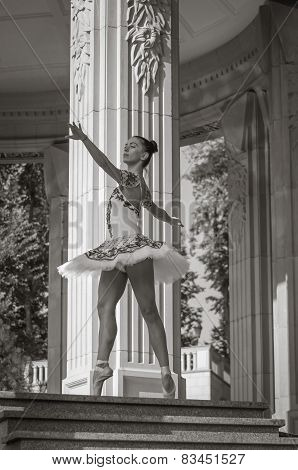 Beautiful Young Ballerina Dancing, Standing In Pointe Position. Outdoors, Spring