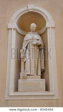 Statue embedded in cathedral wall