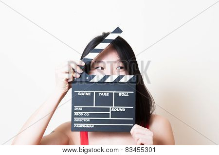 Young Beautiful Asian Woman Closeup Looking Left With Clapperboard
