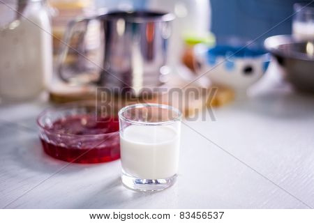 Milk With Red Jam In The Kitchen
