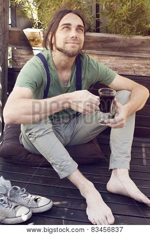 Men With Suspenders Drinking Coffe Barefoot