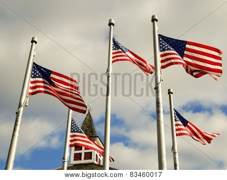 Red White And Blue Flags On A Pole With American Architecture