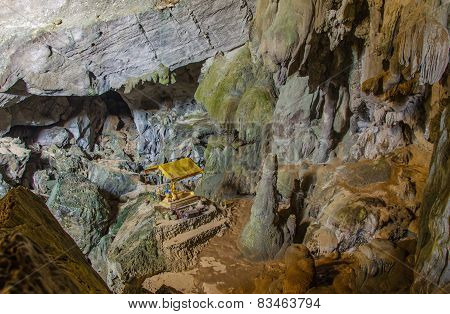 Pavilion Buddha In The Deep Cave At Laos, With Stalagmites And Stalactites