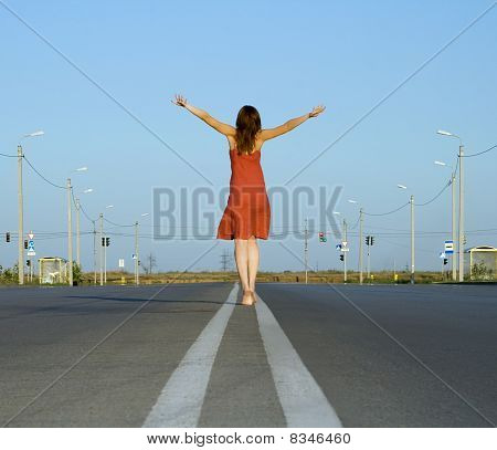 Girl In Red Dress Walk Barefoot On Empty Road