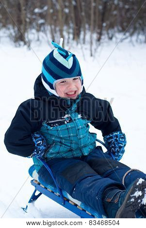 Happy Boy Sledding