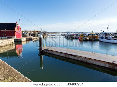 Poole harbour and quay Dorset England UK on a beautiful day with blue sky and white clouds