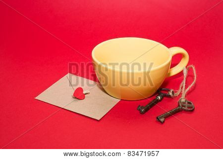 Key, Envelope With Heart Is In The Yellow Cup On A Red Background.