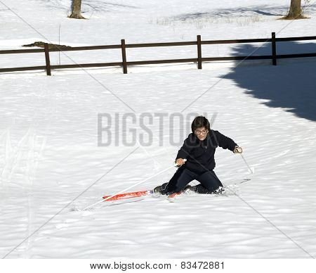 Young Boy Falls With The Cross Country Skiing