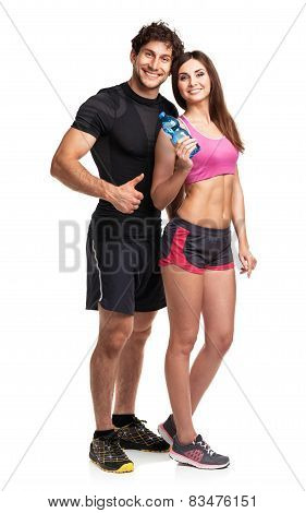 Athletic Couple - Man And Woman With Bottle Of Water On The White