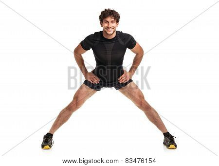 Athletic Attractive Man Doing  Fitness Exersise On The White