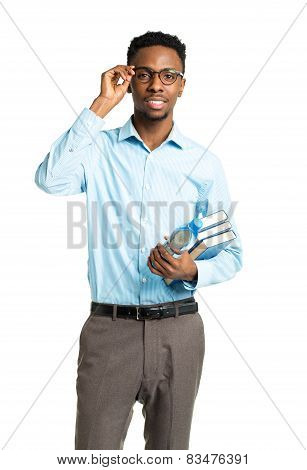 Happy African American College Student With Books And Bottle Of Water In His Hands  Standing On Whit