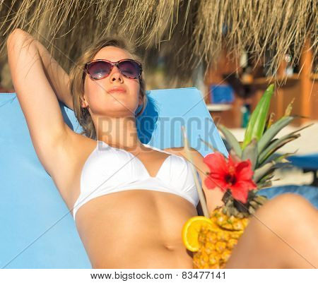 Woman With Cocktail Sunbathing On The Beach Vacation.