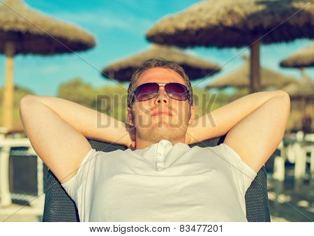 Man Sunbathing On The Beach Vacation.