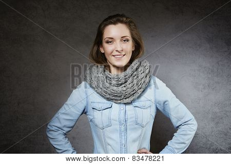 Cheerful young woman in cosy scarf