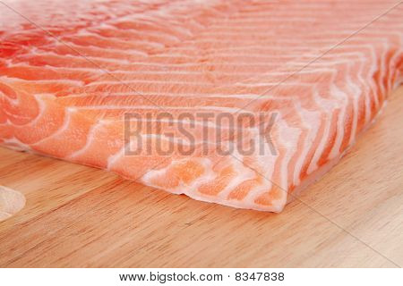 Fresh Uncooked Red Fish Fillet On Wood
