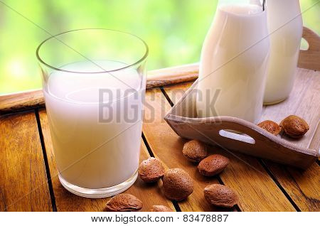 Glass Of Almond Milk On A Table With Almonds