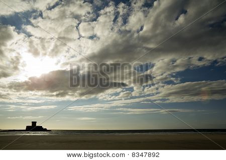 La Rocco Tower under dramatic skies on Jersey coast