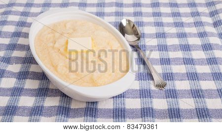 Oval Bowl Of Grits With Butter