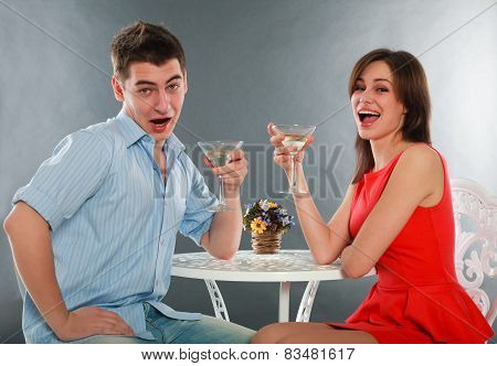 Laugh And Drunk Couple With Glasses Of Champagne At Table, In Studio Isolated On Gray