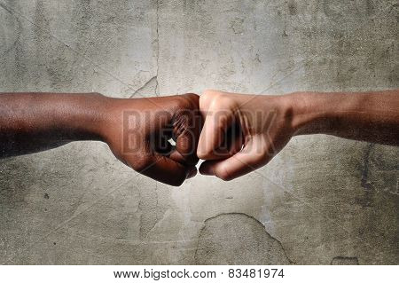 Black African American Race Female Hand Touching Knuckles With White Caucasian Woman In Multiracial