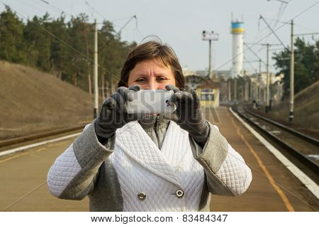 A Woman Takes A Snapshot By Mobile Phone