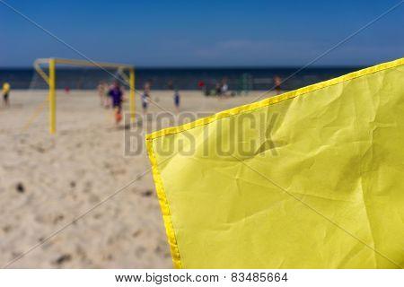Yellow Flag On A Soccer Field On The Beach
