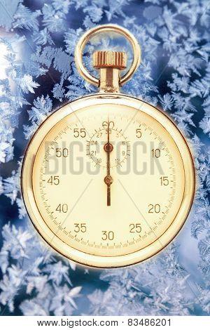 Stopwatch On Winter Window