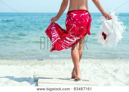 Woman walks at the beach