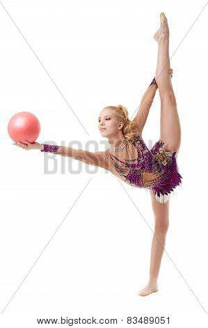 Pretty blonde gymnast dancing with ball