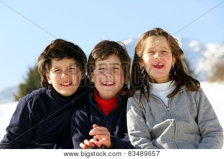 Three Brothers In The Mountains On Snow In Winter