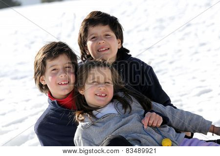 Three Brothers On The Snow In The Mountains In Winter