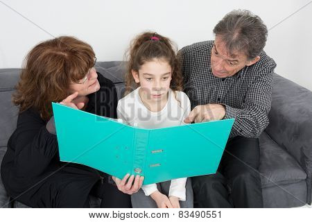 Grandparents And Their Granddaughter